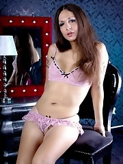 Gorgeous transsexual Nicole posing naughty