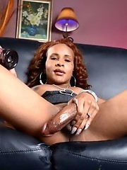 Naughty ebony TS Chyna playing with a penis pump