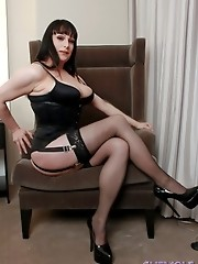 Busty tgirl Tiffany Taylor posing in a sexy corset