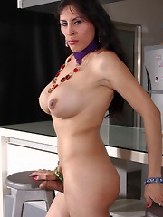 Busty tgirl Mariysa stripping in the kitchen