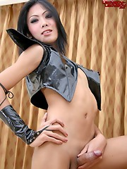 Cute Thai ladyboy strips