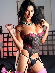 Seductive brunette transsexual Vaniity stripping in bed