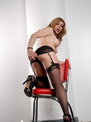 Sexy transsexual MILF posing in hot black stockings