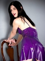 Filthy Mandy posing in hot purple latex dress